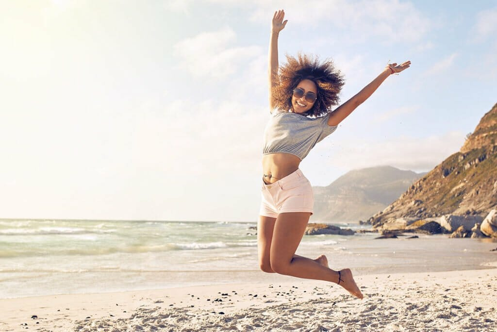 Woman on Beach after Vitamin B12 Shot Spa Treatment in Lamont, Illinois at Solana Aesthetics and Wellness